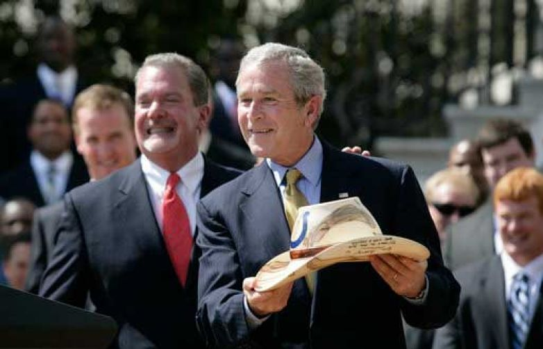 Indianapolis Colts owner Jim Irsay presents President Bush with one of Chris's hats signed by the roster of the 2007 Super Bowl Champions